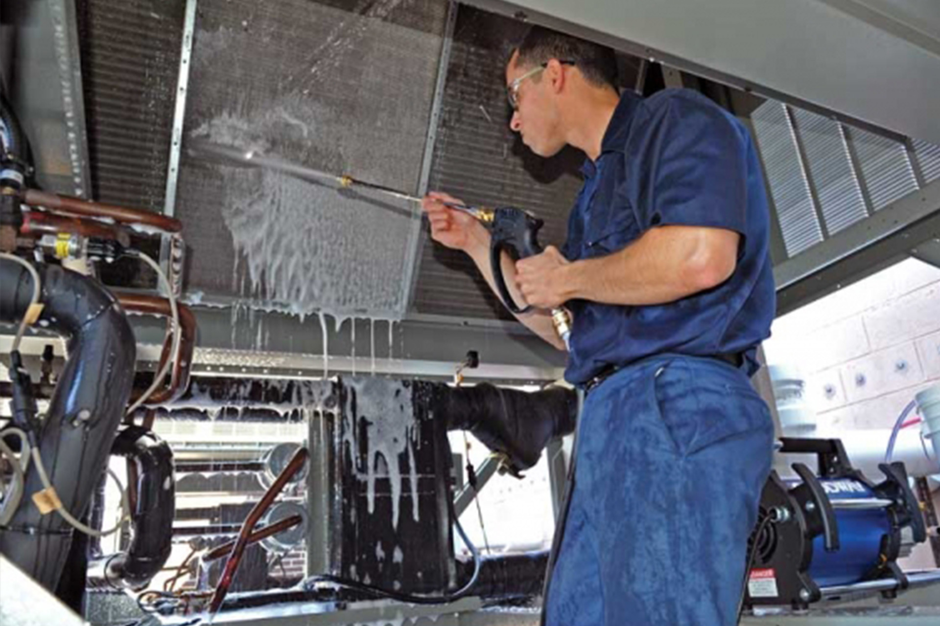 Cleaning coils on condenser units - commercial air conditioning